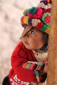 Peruvian little girl decked out in color, upon color, and more color.