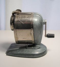 Vintage Boston Champion Pencil Sharpener. We had one attached to a post in the basement.  I loved the smell of the shaved wood.
