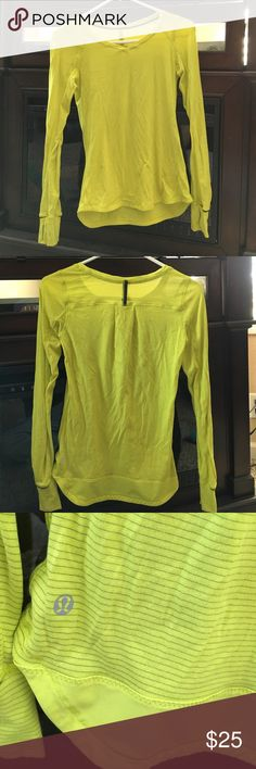 Lululemon long sleeve shirt Yellow/lime green and grey long sleeve lululemon shirt. Thinner material perfect for workouts. Arm sleeves have thumb holes. Super comfy I just never wear.. in great condition lululemon athletica Tops Tees - Long Sleeve