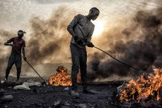 Two teenagers burn the plastic and rubber off of copper wiring in a vast e-waste dump. The slum economy depends on separating garbage from…