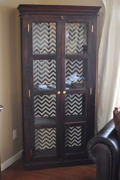 Chevron fabric on back of cabinet.
