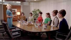 A nice scene of beautiful guest stars in an episode of Madmen.  Eames segmented base table, and Eames executive chairs.