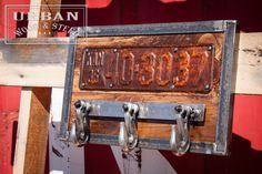 This urban, industrial style chain hook hat, scarf, key rack is made from a vintage license plate, three 5400 lb. capacity chain hooks that still swivel, antique pine and steel. Get this for that man in your life to hang on his shop wall or use it to pull your pickup out of the mud.