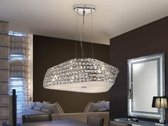Pendant made of metal, chrome finish. Glass shade composed by 6 lines of square K9 faceted clear crystals.