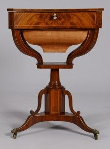 Inlaid Mahogany Classical Sewing Stand Having A Shaped Lift Top With Sting Inlay, Ivory Escutcheon And Fitted Interior, Supported On Turned Column Ad Tripod Base With Brass Paw Feet   c. 2nd Quarter Of The 19th Century