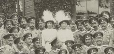 """""""Grand Duchesses Olga and Tatiana with their father and swarm of officers """""""