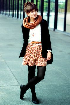 Black tights and flats, colored skirt, brown belt, tee, long pendant necklace, warm scarf