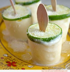 creamy margarita popsicles | 1¼ cup fresh lime juice (about 8 limes), plus 4 limes for stabilizing the popsicle sticks  1 (14oz) can of sweetened condensed milk  1 cup water  ¼ cup tequila  2 tablespoons orange juice (optional)  Kosher salt or margarita salt