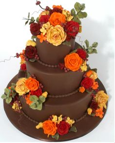 perfect fall wedding cake - Cakeboss....love the pop of color against the brown