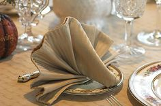 Savoring Time in the Kitchen: Mustard Puffs and How To Make a Turkey Napkin Fold
