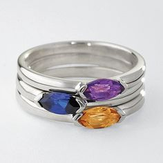 Love my luna stella stacking rings, but I THINK these would be more colorful- as in you could tell ruby from pink October... and aquamarine would actually look blue? $180