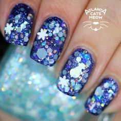A glitterbomb of white and blue that includes iridescent glitters with snowflakes and snowmen.Swatch by @atlcatsmeow