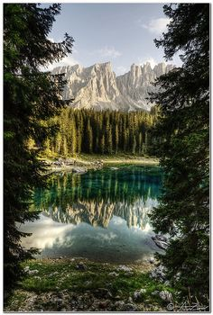 Latemar reflected on Carezza Lake, Italy