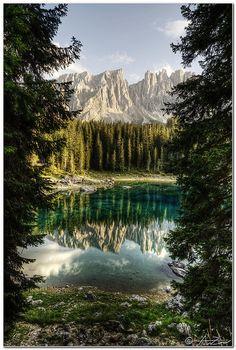 Latemar reflected on Carezza Lake, Italy