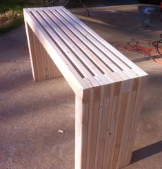 DIY Project:  Make Your Own Slatted Console Table   Ana White stained or painted with a glass top for easy cleaning? make it couch length and add a lamp, etc. for the entry