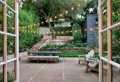 stone and brick patio and terraced, private backyard. Photo: Liz Rusby / SF    Love the levels and the aged brick steps