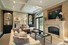Living room  Khaki walls  White trim  Black built-ins Ceiling beams. Love it!