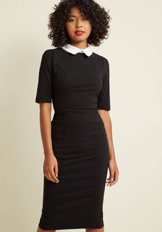 <p>Maybe this little black dress isn't distinctly macabre, but its stylish air of mystery is enough to make you feel frightfully festive. With a white collar evocative of your spooky muse, haute half sleeves, and a stretch-boasting wiggle silhouette, this pocketed midi dress by Collectif is chillingly chic.</p>