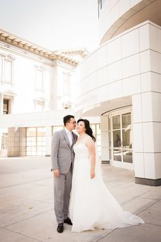 """The couple had their """"first look"""" in front of their wedding venue, Crocker Art Museum. Photographer: Liz Caruana Weddings."""