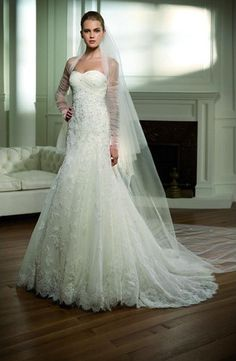 Bought in 2011. Beautiful off white lace wedding dress, features strapless sweetheart neckline, crystal beading on the lace bodice and train and an added bustle to take up the train in the evening if