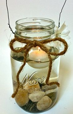Floating candle in a mason jar filled with rocks - need to do this with stones from Lake Michigan!