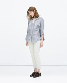 Image 1 of 1-POCKETS STRIPED BLOUSE from Zara
