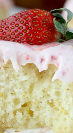Strawberry Champagne Cake ~ An orange infused vanilla cake soaked in a champagne glaze and topped with a tangy strawberry cream cheese frosting.