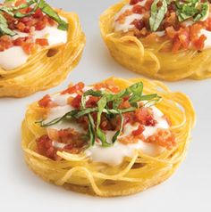 What a fun idea! Bake pasta in muffin cups to form the base for pasta sauce and toppings. Let your imagination run wild with these Angel Hair Pasta Nests. Great for potlucks and cocktail parties.