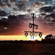 Midsommarstången i Skanör i solnedgång. Den kläs på midsommar och står sedan uppe hela året. Stången är en kopia på den midsommarstång som L... Utility Pole, Sweden, Explore, Exploring
