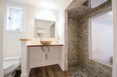 Bathroom Remodel - Bathroom Makeover - Brought to you by Re-Bath of the Triangle. - All Stone Shower - Natural Elements Bathroom Remodel - Bowl Sink - Stone Bathroom Sink - Oversized Walk-in Shower,