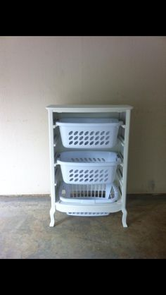Repurposed dresser. Now a laundry basket holder! I also kept the dresser drawers for some other use down the line!