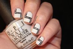 If you've got a steady hand or the patience to work with a few pieces of nail tape, this stylish black-and-white art deco nail design is worth trying. #nails #b&w