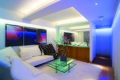 LED light strips in cool white and blue shade for a clean, bright and cool look for the living room! Easy as 1, 2, 3! #LED #LEDlightstrips #LEDinstallations #lightstrips www.ledluxor.com/led-light-strips