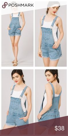 Blue Denim Overall Jean Shorts Denim overall shorts are a medium to light wash and have a comfortable fit, with front and bib pockets. Metal jean side buttons and top buckles open for slipping on. EVIEcarche Pants