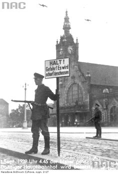 "September 1, 1939. German soldier in Gdansk (Danzing) holding the sign ""Stop! Danger! You will be shot"""