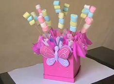 Bombones para centro de mesa para una fiesta de niñas con tema de mariposas