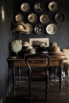 beautiful collection of handmade plates and hats in a dark corner