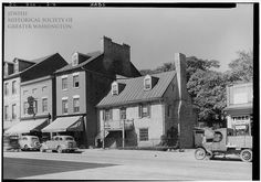 """In the early 1930s, Sam Levy opened a men's clothing store at 3059 M Street, NW. A leading merchant and real estate investor in the neighborhood, Sam Levy became known as """"the mayor of Georgetown."""" If you look closely, you can see the vertical """"SAM'S"""" sign over the leftmost awning in the photo.    Courtesy of Library of Congress, Prints and Photographs Division, HABS, D.C., GEO, 3-4"""