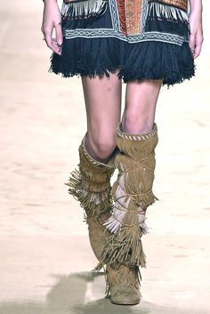 "So far this season, it's been ""That '70s Show"" on the runways — and Etro was no exception. The house showed these swingy fringed boots, which add a dose of attitude to any look. [Photo by Giovanni Giannoni] -  ""Mohawk look"" everybody !!!!"