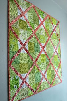 I don't like the coral but I love the tutorial for this lattice baby quilt by Stitchery Dickory Dock.