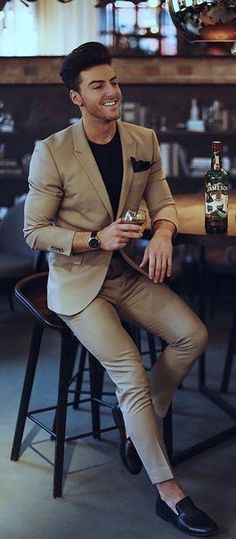 reputable site ad55a f1001 with a business casual combo idea with a tan suit black t-shirt black linen  pocket square black leather banded watch black loafer no show socks.