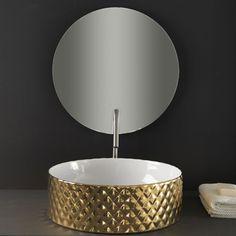 Vasque ronde Ø 44 cm en céramique dorée avec un revêtement damassé sur la paroi extérieure, à poser sur un meuble de salle ou un plan de travail de la collection Millerighe by Artceram, le comble de l'élégance. A découvrir sur espritdubain.com
