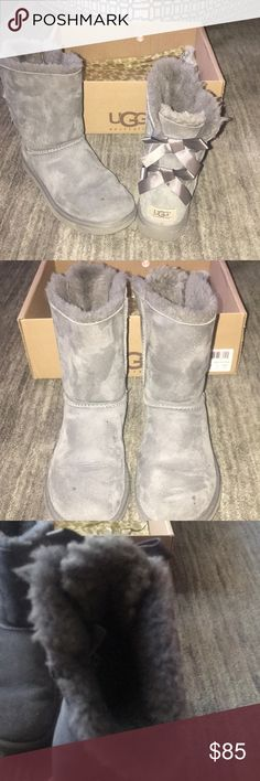 UGG Bailey Bow UGG BAILEY BOW charcoal gray boots with bow detail  in back excellent condition with a few small watermarks as pictured in front( price will reflect). Non-smoking home only worn with socks. Women's size 6 or could be worn if it was a kids size 4. UGG Shoes Winter & Rain Boots