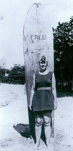 Agatha Christie and her surf board, Fred, 1922