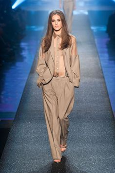 Jean Paul Gaultier Spring 2013  Even though so much of it referenced what Gaultier did then, there was a lot that felt of the moment. Like a brownish men's suit worn with a sheer shirt that matched sheer detailing on the jacket shoulders.