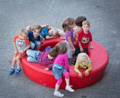 Children playing on LOOP. LOOP is a playful and informal urban element by out-sider, Denmark. LOOP is available in 12 colors. Made in rotation moulded polyethylene, sturdy, UV-resistant, and suitable for complete recycling. Street Furniture, Urban Design, Kids Playing, Children, Recycling, Plastic, Colors, Outdoor, Benches