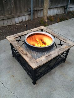 I have seen tons of people using a washing machine tub for a fire pit, so I decided to give it a try.  I found a washer on CL for free and ripped it apart for the tub.  I still kept the old fire pit frame, just to make sure that no one accidentally touches it.  It's working good so far and puts out more heat than the old one did.  The holes in the side help with the heat and air flow, plus they look really cool at night.