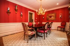 Dramatic Red Dining Room with White Molding and Gold Accents. Home in Chatham NJ - SOLD by Debbie Woerner www.debbiewoerner.com -