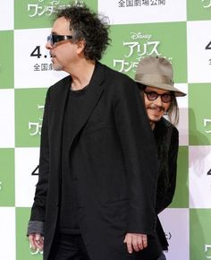 Tim Burton photobombed by Jonny Depp :D