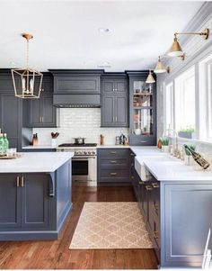36 Best Beautiful Blue and White Kitchens to Love! - Hello Lovely : Slate blue kitchen cabinets and brass lighting in this classic kitchen. Kitchen Ikea, Dark Kitchen Cabinets, Kitchen Paint, Kitchen Flooring, Kitchen Interior, Gray Cabinets, Kitchen Backsplash, Kitchen Wood, Kitchen Fixtures